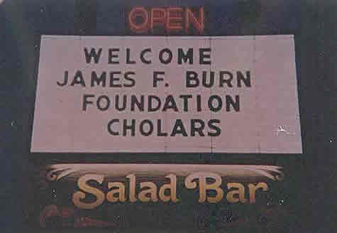 A sign welcomes the burn cholars.